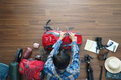 Overhead view of traveler man plan and backpack planning vacation travel Royalty Free Stock Photography
