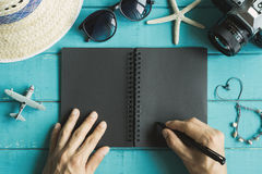 Overhead view of Traveler`s accessories and items with notebook stock photos