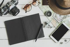 Overhead view of Traveler`s accessories and items with notebook Stock Images