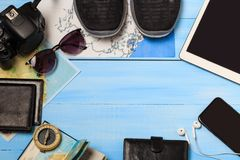 Overhead view of traveler`s accessories. Travel concept background. Essential vacation items, tourism mockup. Space for text.  royalty free stock photos