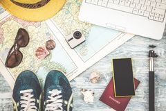 Overhead view of Traveler`s accessories Travel plan, trip vacation, tourism mockup Instagram looking image of travelling concept. Royalty Free Stock Photo