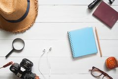Overhead view of Traveler`s items, Vacation accessories, Travel. Concept on white wooden background stock image
