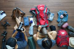 Overhead view of Traveler young couple planning honeymoon vacation trip Royalty Free Stock Images