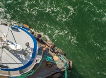 Overhead view of tugboat, ropes and workers assisting ship to dock, Alaska, USA. stock images