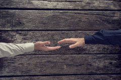 Overhead view of two businessman about to shake hands Royalty Free Stock Photography
