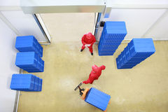 Overhead view of two workers  in small warehouse Stock Photos
