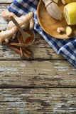 Overhead view of various food with checked napkin on weathered table Stock Photo