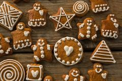 Overhead view of various ginger bread cookies. On wooden table Stock Photos