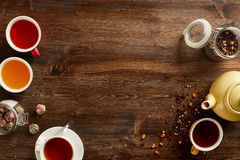Various sorts of tea and coffee with copyspace. Overhead view of various sorts of tea and coffee. Flavoured with Assorted Herbs and coffee beans on a rustic wood stock photography