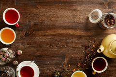 Various sorts of tea and coffee. Overhead view of various sorts of tea and coffee. Flavoured with Assorted Herbs and coffee beans on a rustic wood board royalty free stock photo