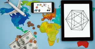 Overhead view of various structures in smart phone and digital tablet by airplane with currency on w Stock Photos