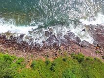 Overhead view of waves crashing on the rocky shore of Lake Superior. Aerial drone view of waves crashing on the rocky shore of Lake Superior Stock Photo