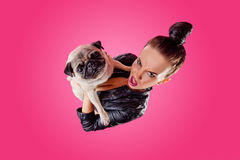 Overhead view of woman with pug Stock Photo