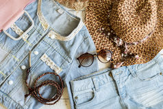 Overhead view of womens cloths shirt and accessories royalty free stock photo