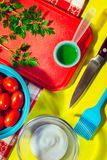 Overhead view of a yellow kitchen table with ingredients Royalty Free Stock Photo