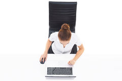 Overhead view of a young, confident businesswoman with laptop. B Royalty Free Stock Image