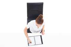 Overhead view of a young, confident businesswoman with organizer Stock Photography