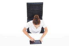 Overhead view of a young, confident businesswoman with tablet co Royalty Free Stock Image