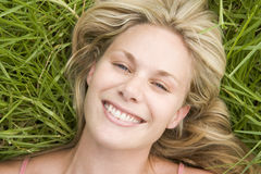 Overhead view of young woman lying on grass Royalty Free Stock Photo