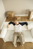 Overhead View Of Young Woman Moving Into New Home Stock Image