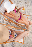 Overhead view of young women sitting on the beach Royalty Free Stock Image