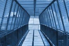 Overhead walking bridge with mesh Stock Photo
