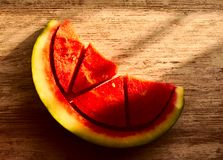 Watermelon cut in four parts stock photos
