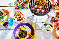 Overhead Well Laid summer table with colorful dish and brazier Royalty Free Stock Photo