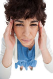 Overhead of woman with a headache touching her temples Royalty Free Stock Images