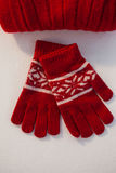Overhead of wooly hat and gloves. On white background Royalty Free Stock Photo