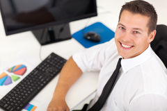 Overhead young businessman. Overhead view of young businessman sitting in office Royalty Free Stock Photos