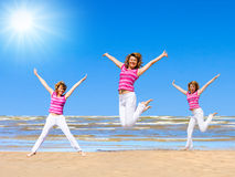 Overjoy. Of one girl shot three times  on a beach Royalty Free Stock Photo