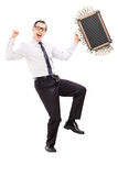 Overjoyed businessman with briefcase full of money Royalty Free Stock Photo