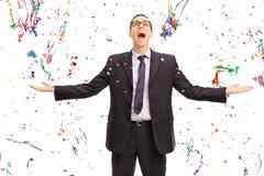 Overjoyed businessman with confetti around him Royalty Free Stock Image