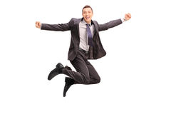 Overjoyed businessman jumping and gesturing happiness Stock Photography