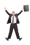Overjoyed businessman shot in mid-air Stock Photography