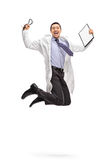 Overjoyed doctor jumping out of joy Stock Photo