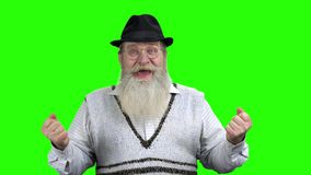 Overjoyed elderly man celebrating success. stock video