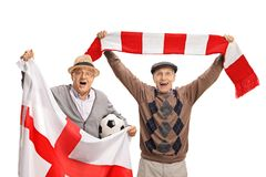 Overjoyed elderly soccer fans with an English flag and a scarf. Isolated on white background Stock Photos