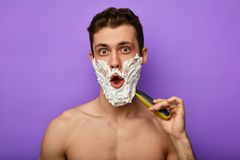 Overjoyed excited man openes mouth wide, being glad to have a day off royalty free stock image