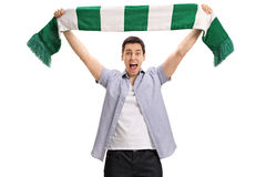 Overjoyed football fan holding a scarf and cheering. Isolated on white background Stock Photo