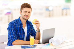 Overjoyed freelancer sitting at the table Royalty Free Stock Photo