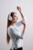 Overjoyed girl listening to music Royalty Free Stock Image