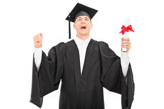Overjoyed graduate student holding a diploma Royalty Free Stock Images