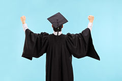 Overjoyed graduate student with raised fists Stock Images