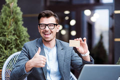 Overjoyed man holding gold card Stock Photography