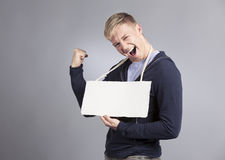 Overjoyed man presenting empty signboard. Royalty Free Stock Photo
