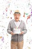 Overjoyed senior holding a birthday cake Royalty Free Stock Photos