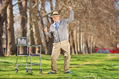 Overjoyed senior man standing up from a wheelchair Royalty Free Stock Images
