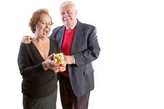 Overjoyed senior woman receiving a Valentines gift Stock Photo